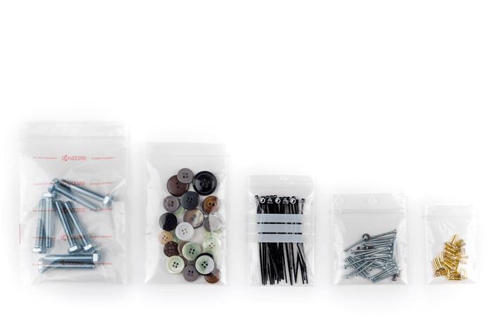WeGrip, buste ermetiche con chiusura a pressione, contenente vari oggetti, come viti, bottoni e forcine